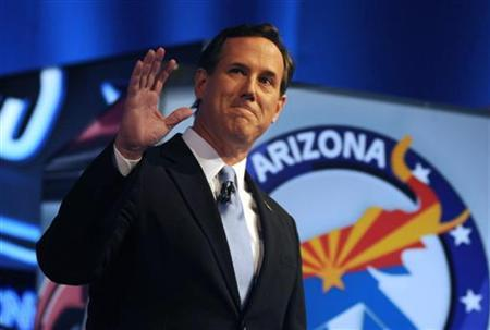 U.S. Republican presidential candidate former U.S. Senator Rick Santorum waves before the start of the Republican presidential candidates debate in Mesa, Arizona, February 22, 2012. REUTERS/Laura Segall