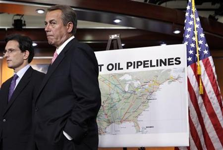 U.S. House Speaker John Boehner (R-OH) (R) stands next to House Majority Leader Eric Cantor (R-VA) near a map of current oil pipelines in the U.S. during the GOP news conference about the Keystone XL pipeline decision on Capitol Hill in Washington January 18, 2012. REUTERS/Yuri Gripas