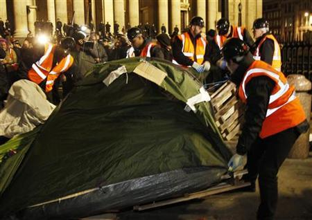 Bailiffs remove tents from the Occupy encampment in front of St Paul's Cathedral in London February 28, 2012. REUTERS/Chris Helgren