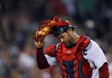 Boston Red Sox catcher Jason Varitek walks back to the dugout at the end of the ninth inning of their MLB American League baseball game against the Baltimore Orioles at Fenway Park in Boston, Massachusetts September 21, 2011.   REUTERS/Brian Snyder