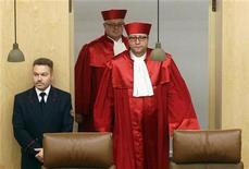 President of the German Constitutional Court Andreas Vosskuhle (R) arrives for the proclamation of a verdict on German parliament's role in Europe's EFSF bailout fund in Karlsruhe February 28, 2012. 