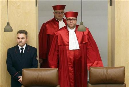 President of the German Constitutional Court Andreas Vosskuhle (R) arrives for the proclamation of a verdict on German parliament's role in Europe's EFSF bailout fund in Karlsruhe February 28, 2012. REUTERS/Alex Domanski (GERMANY - Tags: POLITICS)