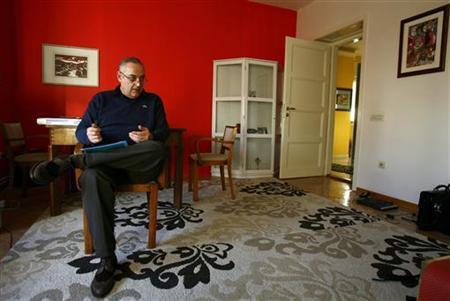 Doctor Nenad Borojevic is pictured at home in Belgrade, December 26, 2011. REUTERS/Djordje Kojadinovic