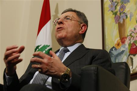 Fouad Siniora, a Lebanese leading Sunni Muslim politician and former prime minister, speaks during an interview with Reuters in Beirut February 27, 2012. Moscow may soften its opposition to coordinated international action against Syrian President Bashar al-Assad after Russia holds its presidential election next week, Siniora said.    REUTERS/Jamal Saidi