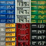 A combination picture shows price boards at various petrol stations in Dortmund February 23, 2011. REUTERS/Ina Fassbender (GERMANY - Tags: TRANSPORT BUSINESS)