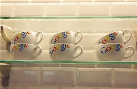 Google bowls are seen in the new headquarters of Google France before its official inauguration in Paris December 6, 2011.   REUTERS/Jacques Brinon/Pool