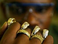 A worker displays gold rings crafted in South Africa in a file photo.  REUTERS/Juda Ngwenya