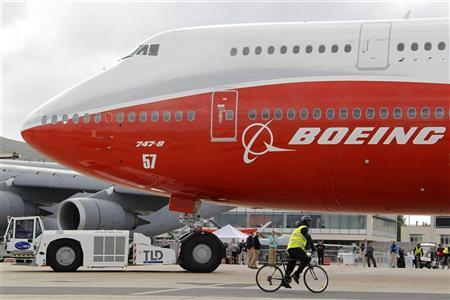 Workers move the new Boeing 747-8 Intercontinental jetliner into a static display on the eve of the Paris Air Show at Le Bourget airport near Paris June 19, 2011. REUTERS/Pascal Rossignol