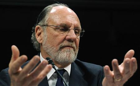 Former MF Global CEO Jon Corzine gestures as he testifies before a House Financial Services Committee Oversight and Investigations Subcommittee hearing on the collapse of MF Global, at the U.S. Capitol in Washington, December 15, 2011. REUTERS/Jonathan Ernst