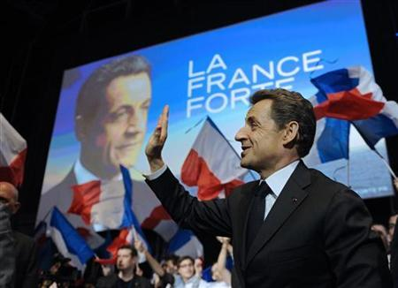 Nicolas Sarkozy, France's President and UMP party candidate for the 2012 French presidential election, waves as he arrives at a campaign rally in Montpellier, February 28, 2012. REUTERS/Eric Feferberg/Pool