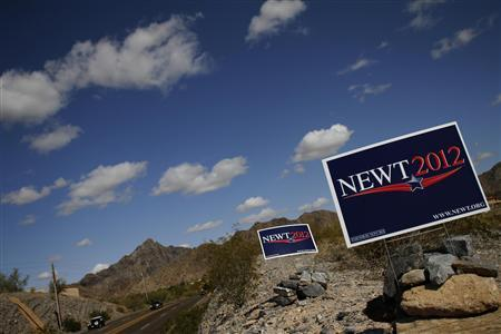 Campaign signs for Newt Gingrich are displayed along 32nd Street in Paradise Valley, Arizona, February 28, 2012.REUTERS/Joshua Lott