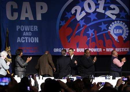 President Obama is greeted as he arrives to deliver remarks at the United Auto Workers conference in Washington, February 28, 2012.   REUTERS/Kevin Lamarque