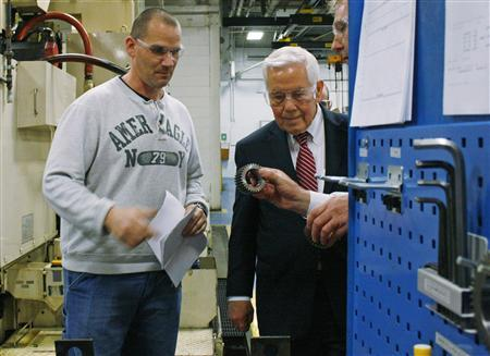 Workers at the Oerlikon Fairfield manufacturing plant in Lafayette, Indiana, shows Senator Dick Lugar some of their products, February 24, 2012.  REUTERS/Nick Carey