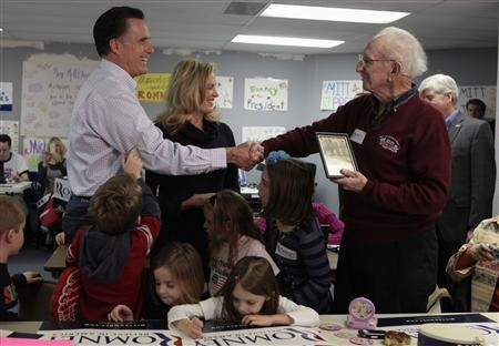 Mitt Romney and his wife Ann greet supporter Bob Smith during a stop at Romney's Michigan campaign headquarters in Livonia February 28, 2012. Smith campaigned for Romney's father, former Michigan Governor George Romney, when he ran for U.S. president in the 1960s. REUTERS/Rebecca Cook