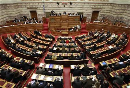 Greek lawmakers attend a parliament session in Athens, February 28, 2012. REUTERS/John Kolesidis