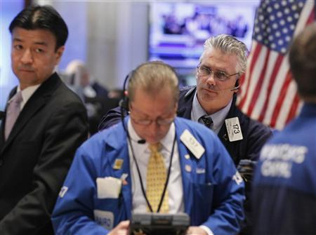 Traders work on the floor just before the closing bell at the New York Stock Exchange February 28, 2012. REUTERS/Brendan McDermid