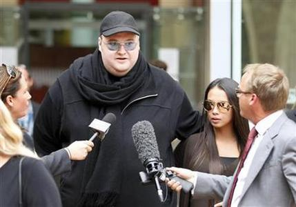 Megaupload founder Kim Dotcom talks to members of the media as he leaves the High Court in Auckland February 29, 2012. REUTERS/Simon Watts