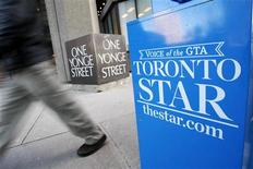 A pedestrian walks past a Toronto Star newspaper box in front of the Toronto Star building at One Yonge Street in Toronto January 18, 2008.    REUTERS/Mark Blinch