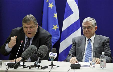 Greece's Finance Minister Evangelos Venizelos (L) and Prime Minister Lucas Papademos hold a joint news conference after a Eurogroup meeting in Brussels, in this February 21, 2012 file photo. In interviews with dozens of players involved in the seven months of talks among banks, national governments, the European Union, European Central Bank and International Monetary Fund, Reuters has pieced together how the agreement - Greece's second bailout - came together and how close it came to failing.       REUTERS/Yves Herman/Files