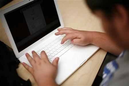 A high school student uses a laptop in a file photo.  REUTERS/Eric Thayer