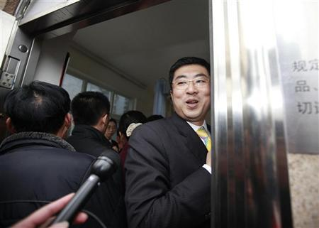 Ma Dongxiao, a lawyer representing Proview Technology (Shenzhen), smiles at reporters as he walks into the Higher People's Court of Guangdong in Guangzhou, Guangdong province  February 29, 2012. REUTERS/Alvin Chan