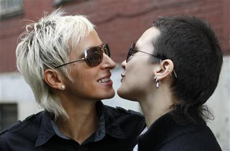 Lesbian couple Irina Shepitko (L) and Irina Fyet approach for a kiss in front of Tverskoy District Court in central Moscow, August 26, 2009. REUTERS/Denis Sinyakov/Files