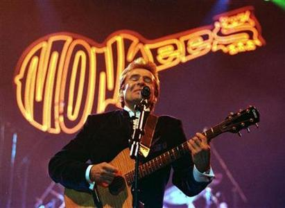 Lead singer of the The Monkees, Davy Jones, sings on stage at the Newcastle Arena March 7 1997. REUTERS/Dan Chung