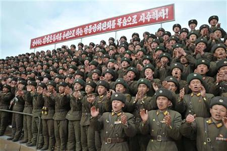North Korean soldiers applaud as North Korean leader Kim Jong-Un (not seen in photo) visits a unit under the command of the Korean People's Army 4th Corps stationed in the southwestern sector of North Korea, in this undated picture released by the North's KCNA in Pyongyang February 26, 2012. REUTERS/KCNA
