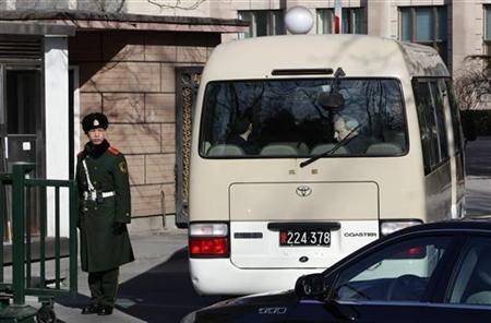 A bus carrying U.S. Special Representative for North Korea Glyn Davies and his team arrive at the North Korean embassy for bilateral talks in Beijing February 23, 2012.  REUTERS/Jason Lee