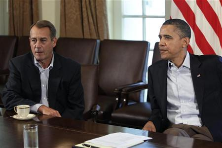 President Barack Obama and House Speaker John Boehner sit during a meeting about the debt limit at the White House in Washington, July 23, 2011. REUTERS/Yuri Gripas
