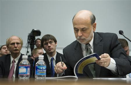 Fed Chairman Ben Bernanke looks at notes during testimony about monetary policy before the House Financial Services on Capitol Hill, February 29, 2012.  REUTERS/Jonathan Ernst