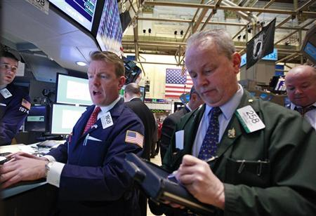 Specialist Trader Mike O'Mara (L) gives a price on the floor of the New York Stock Exchange February 28, 2012. REUTERS/Brendan McDermid
