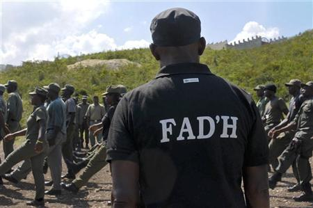 Soldiers from the Armed Forces of Haiti (FAd'H) train in Port-au-Prince October 31, 2011. Haiti's president plans to officially reinstate the country's armed forces, which was disbanded in 1995 .   REUTERS/Swoan Parker