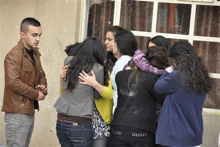 Students grieve after a student shot dead his American teacher at a school in Sulaimaniya, 260 km (162 miles) northeast of Baghdad March 1, 2012. An Iraqi student shot dead his American teacher and then shot himself in northern Iraq's autonomous Kurdish region on Thursday, the provincial governor said.  REUTERS/Nali