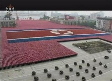 North Korean soldiers form a giant North Korean flag during a military parade in Pyongyang's central square in this still image taken from video September 9, 2011. REUTERS/KRT via Reuters TV/Files