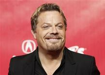 British comedian Eddie Izzard poses at the 2012 MusiCares Person of the Year tribute honoring Paul McCartney in Los Angeles February 10, 2012. REUTERS/Danny Moloshok
