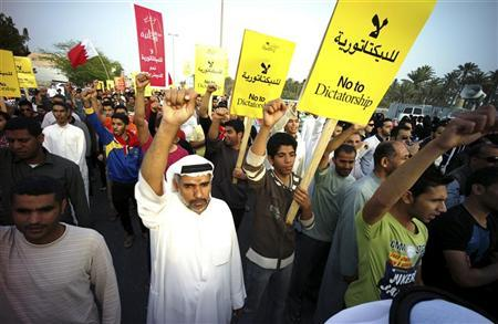 Anti-government protesters shout slogans during a demonstration organised by the opposition Wefaq party in Bilad al-Qateem, west of Manama, February 24, 2012. REUTERS/Hamad I Mohammed