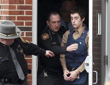 Alleged gunman TJ Lane is escorted out of the Geauga County Courthouse Annex by Sheriff deputies for his court appearance after shooting and killing three students and wounding two others  at Chardon High School in Chardon, Ohio February 28, 2012. REUTERS/Aaron Josefczyk