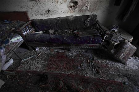 Blood stains left by a 70-year-old woman who was killed in the room after heavy shelling by government forces in Sermeen near the northern city of Idlib February 28, 2012. REUTERS/Zohra Bensemra