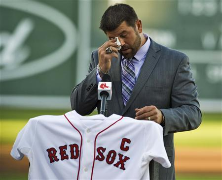 Boston Red Sox catcher Jason Varitek wipes his eye as he announces his retirement from baseball during a news conference at the team's spring training complex in Fort Myers, Florida, March 1, 2012. REUTERS/Steve Nesius