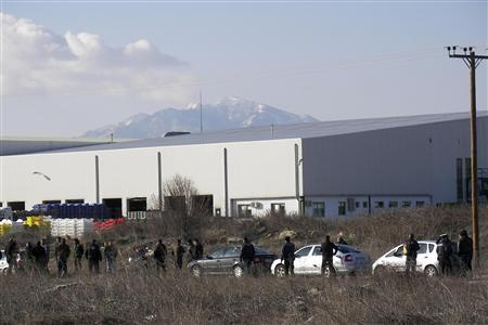 Police secure an area around a factory where a man took two hostages in Komotini town in northern Greece, March 1, 2012.  REUTERS/Stringer