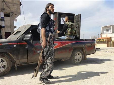 Members of the Free Syrian Army are seen deployed in al-Bayada district in Homs, February 28, 2012. REUTERS/Stringer