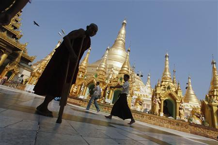A disabled Buddhist monk walks on the grounds of Shwedagon Pagoda during the 2,600th anniversary of the pagoda in Yangon February 29, 2012. REUTERS/Soe Zeya Tun