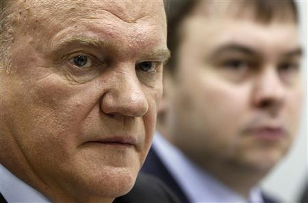 Presidential candidate and leader of the Russian Communist Party Gennady Zyuganov (L) attends a news conference in Moscow, March 2, 2012. REUTERS/Sergei Karpukhin