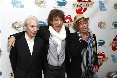 Rolling Stones band members (L-R) Charles Watts, Mick Jagger, and Keith Richards pose as they arrive for the premiere of the documentary film ''Stones In Exile'' in New York May 11, 2010. REUTERS/Lucas Jackson