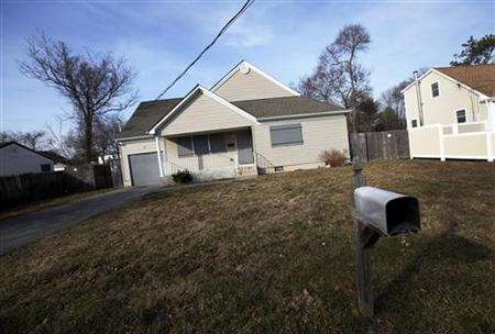 A home is seen padlocked and boarded up in Brentwood, New York, February 10, 2012.  REUTERS/Shannon Stapleton