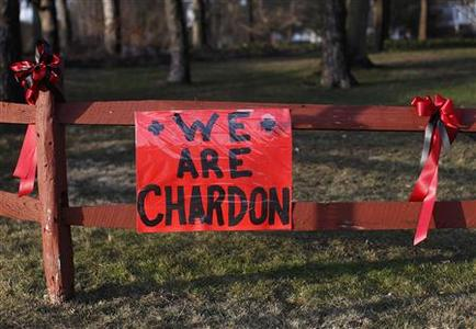A sign remembering the victims of the Chardon High school shooting in Chardon, Ohio, is seen on a fence, February 29, 2012. REUTERS/Shannon Stapleton