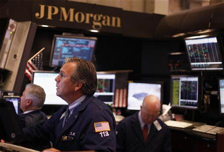 Traders work in the JP Morgan company stall on the floor of the New York Stock Exchange in New York July 15, 2010.  REUTERS/Lucas Jackson