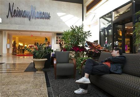 A man sleeps on a couch outside of a Neiman Marcus store at South Park mall in Charlotte, North Carolina November 25, 2011.  REUTERS/Chris Keane