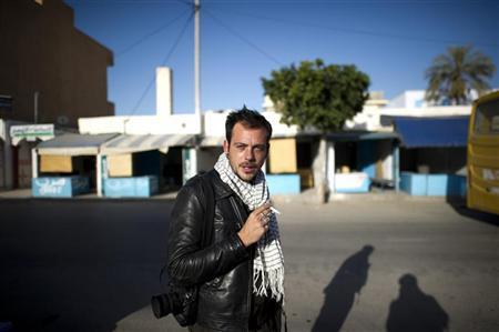 Undated picture of French photographer Remi Ochlik, covering the Tunisian revolution in Ben Guerdane, Tunisia.  REUTERS/Yoan Valat/Handout